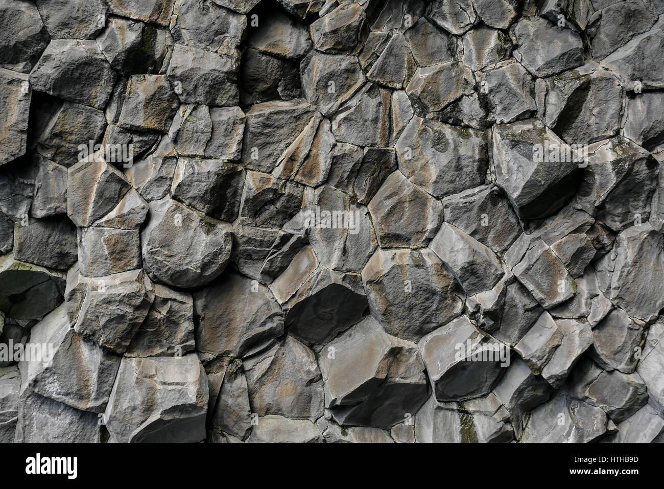 Volcanic basalt rock hexagon background pattern, Reynisfjara, Iceland - Stock Image