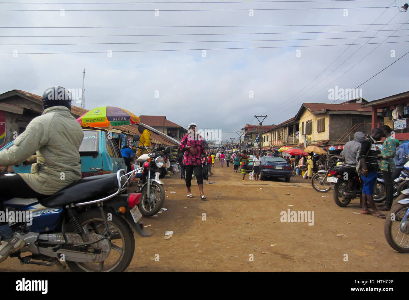 People trading in the street in the city of Lagos, the largest city in Nigeria and the African continent. Lagos - Stock Image