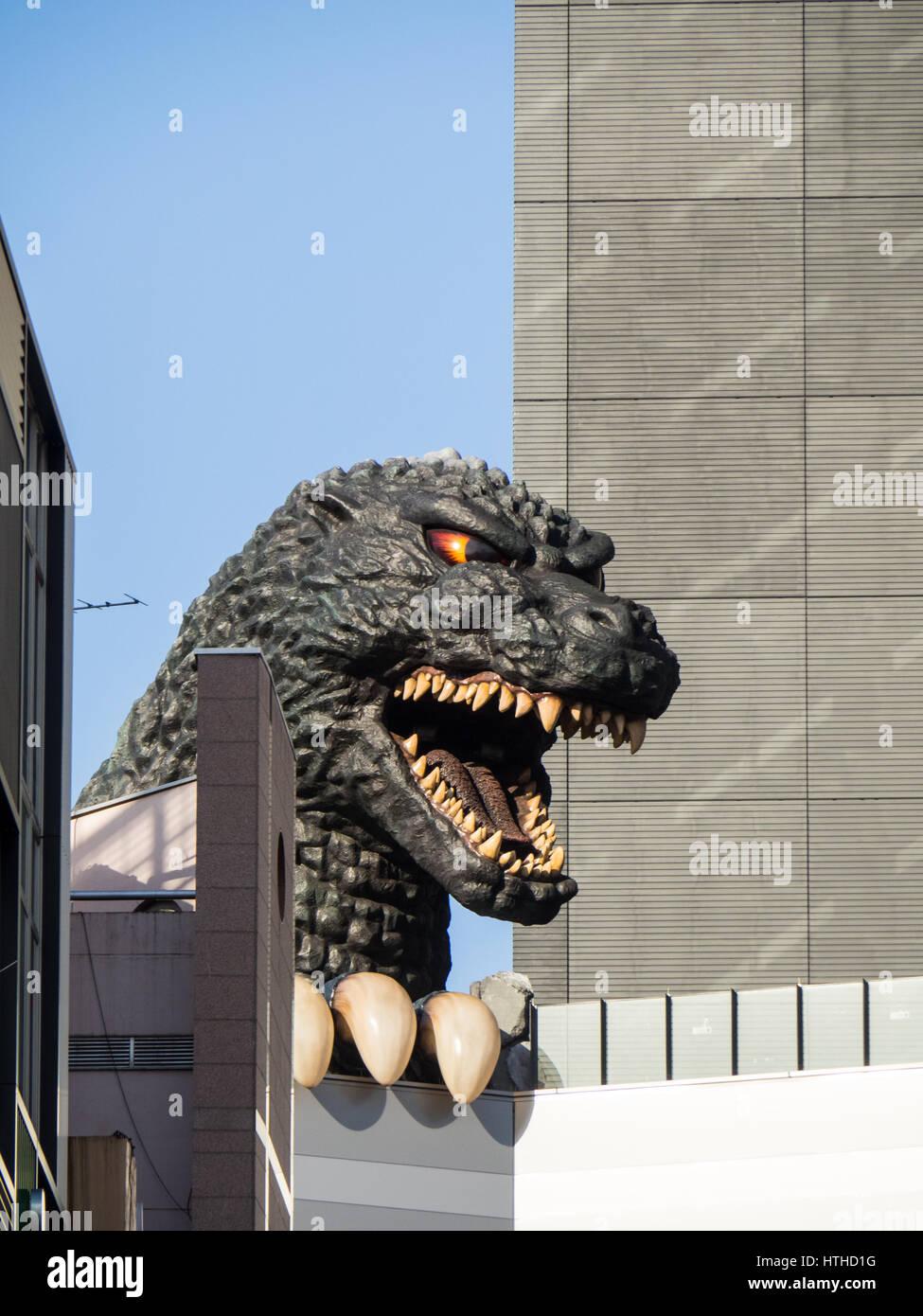 Bust of mythical creature Godzilla on to of the Toho cinemas next to the Gracery Hotel, Kabukicho Shinjuku Tokyo - Stock Image