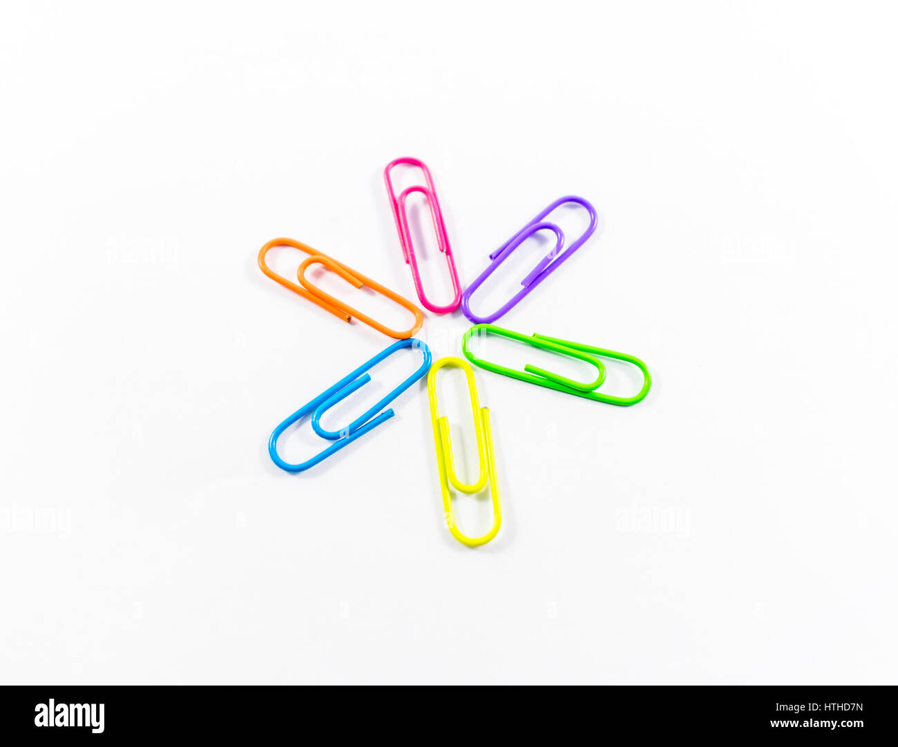Office paper clips isolated on white background - Stock Image