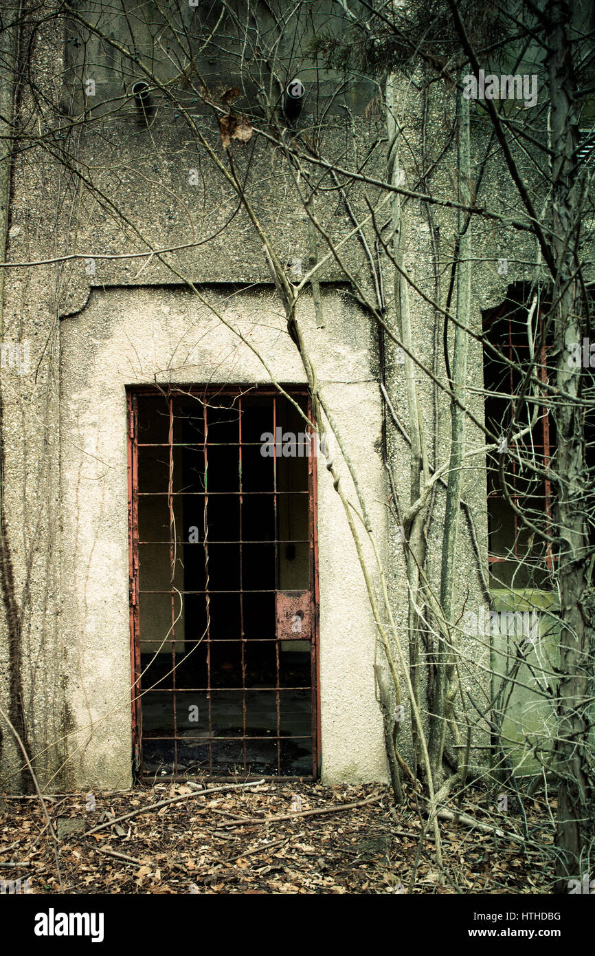 View of exterior of abandoned psychiatric hospital - Stock Image