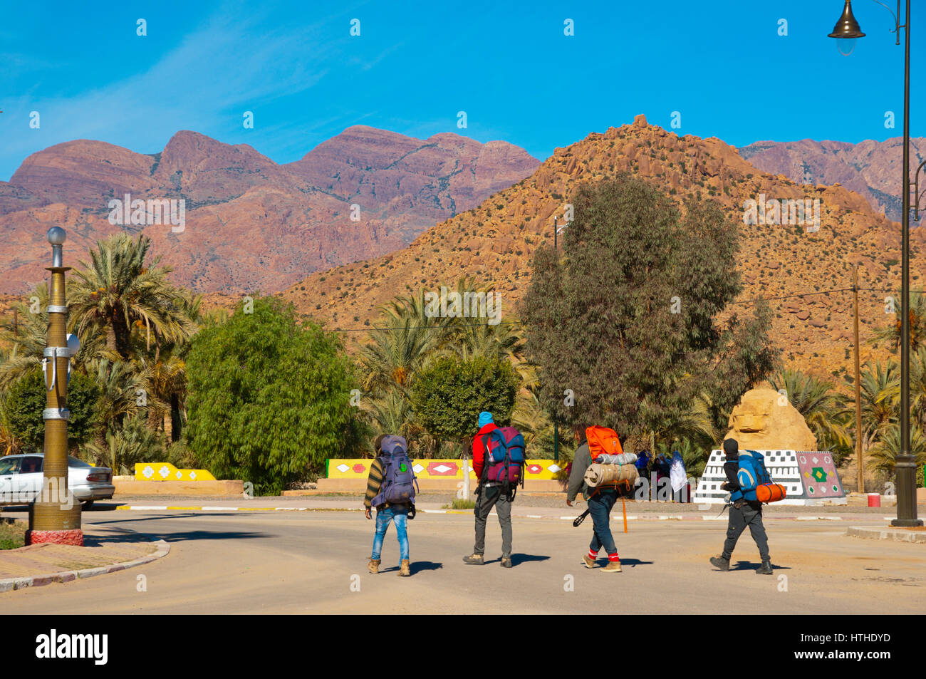 Hikers, with backpacks, Tafraout, Souss Massa region, Morocco - Stock Image