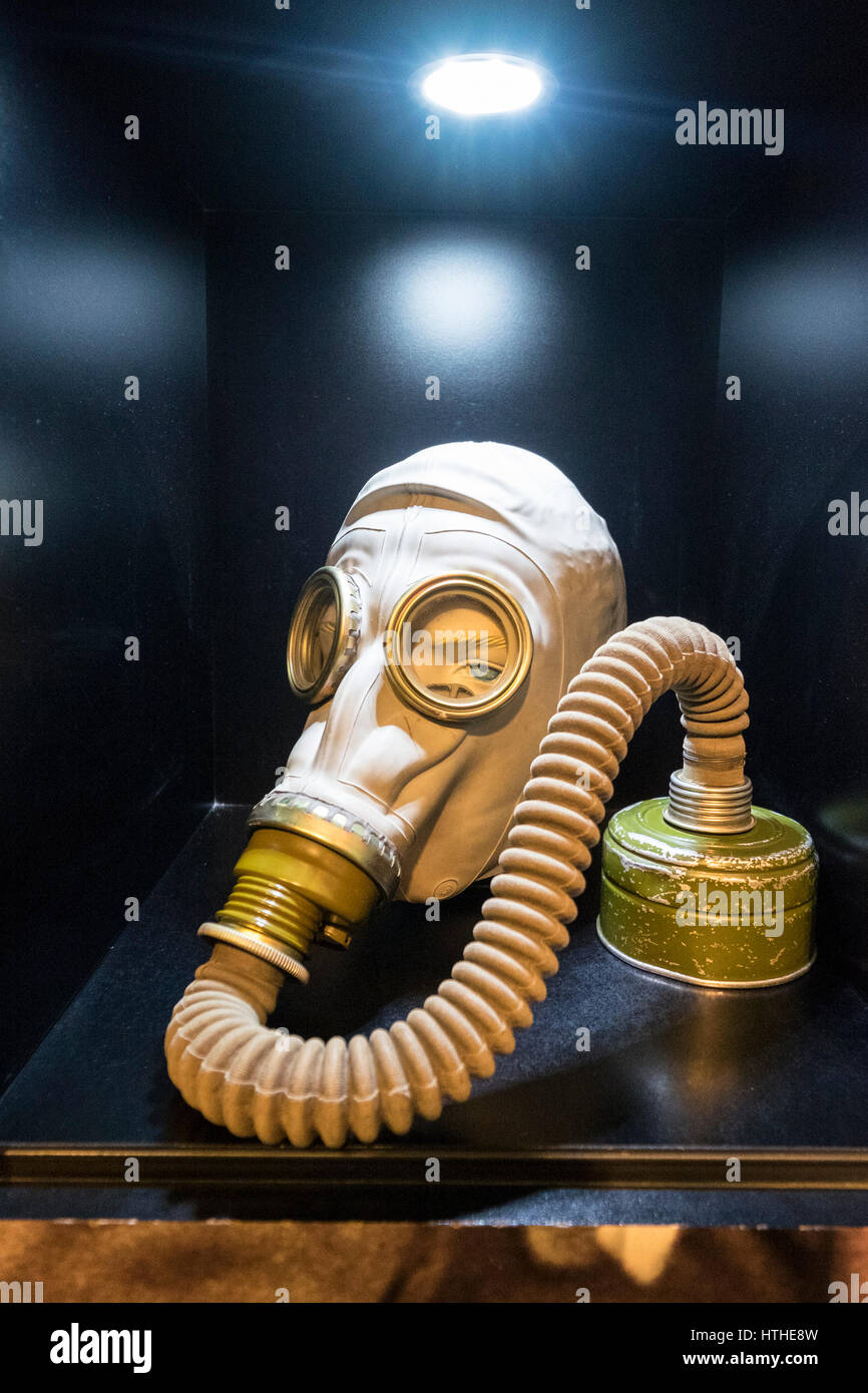 Military gas mask on display at DDR Museum, showing life in former East Germany,  in Mitte Berlin, Germany - Stock Image