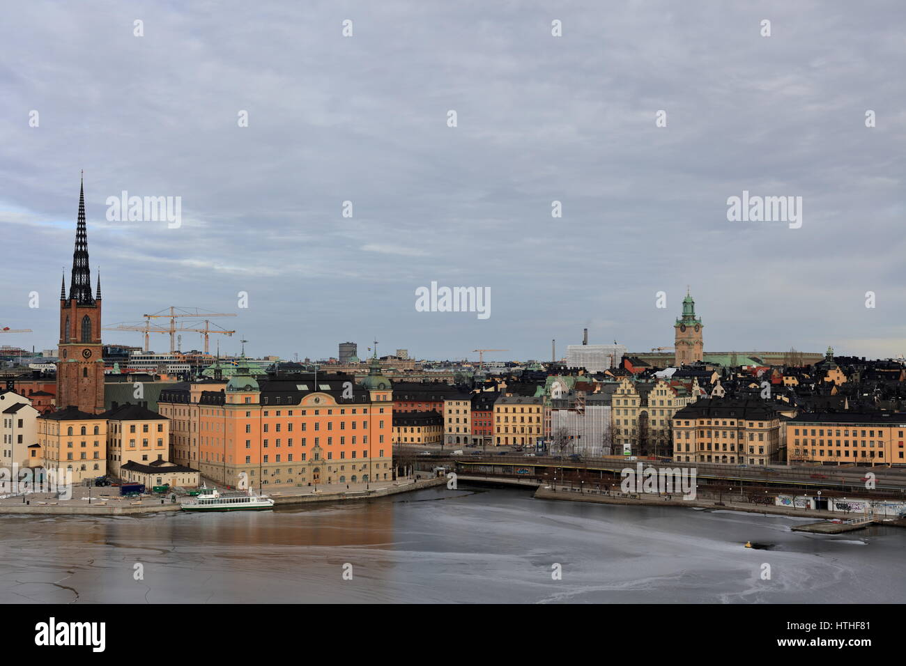 Stockholm in early spring with partially frozen sea, taken from Södermalm - Stock Image