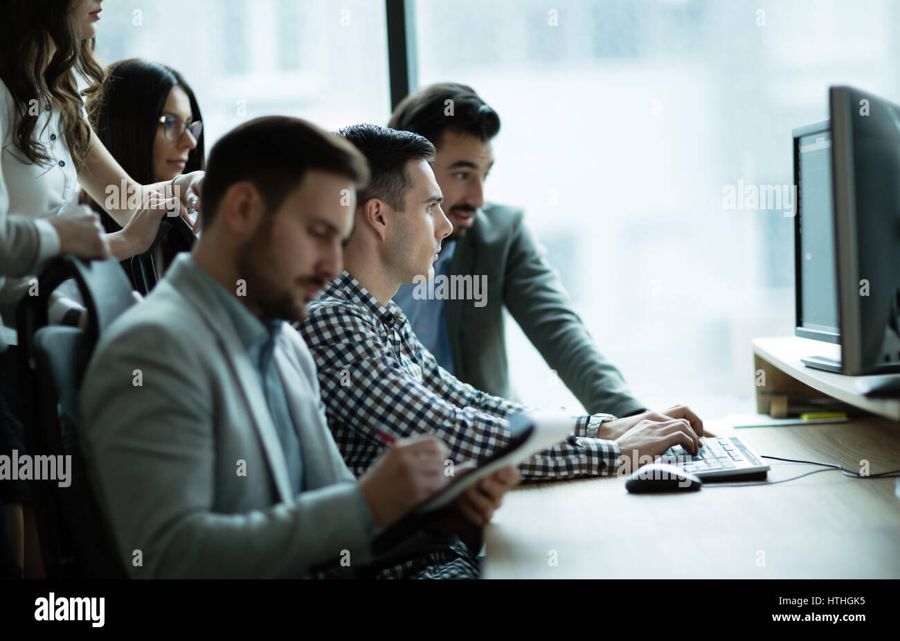 Business colleagues at information technology company offices - Stock Image