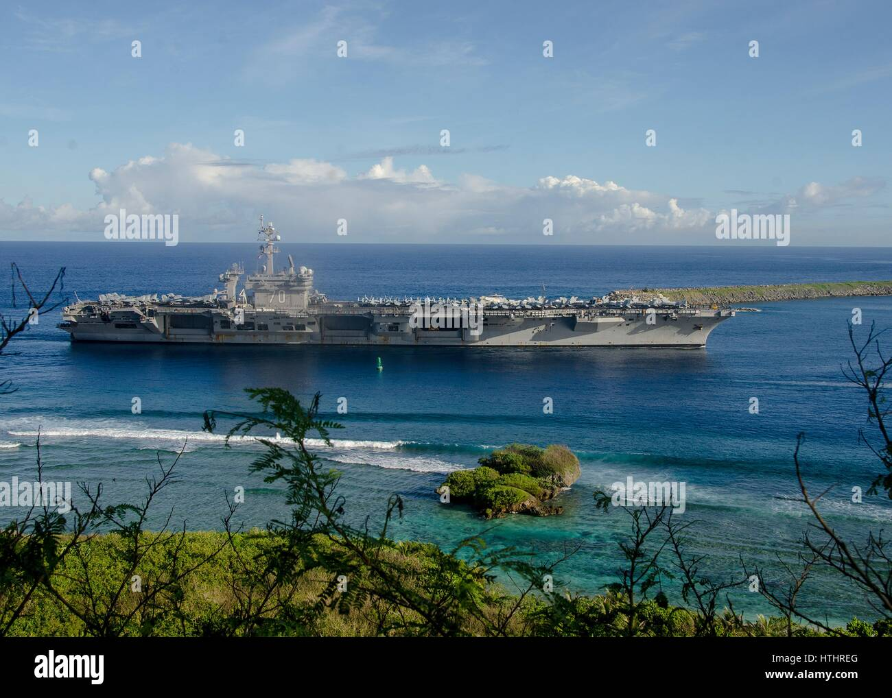 The US Navy Nimitz-class aircraft carrier USS Carl Vinson arrives at the Naval Base Guam February 10, 2017 in Santa - Stock Image