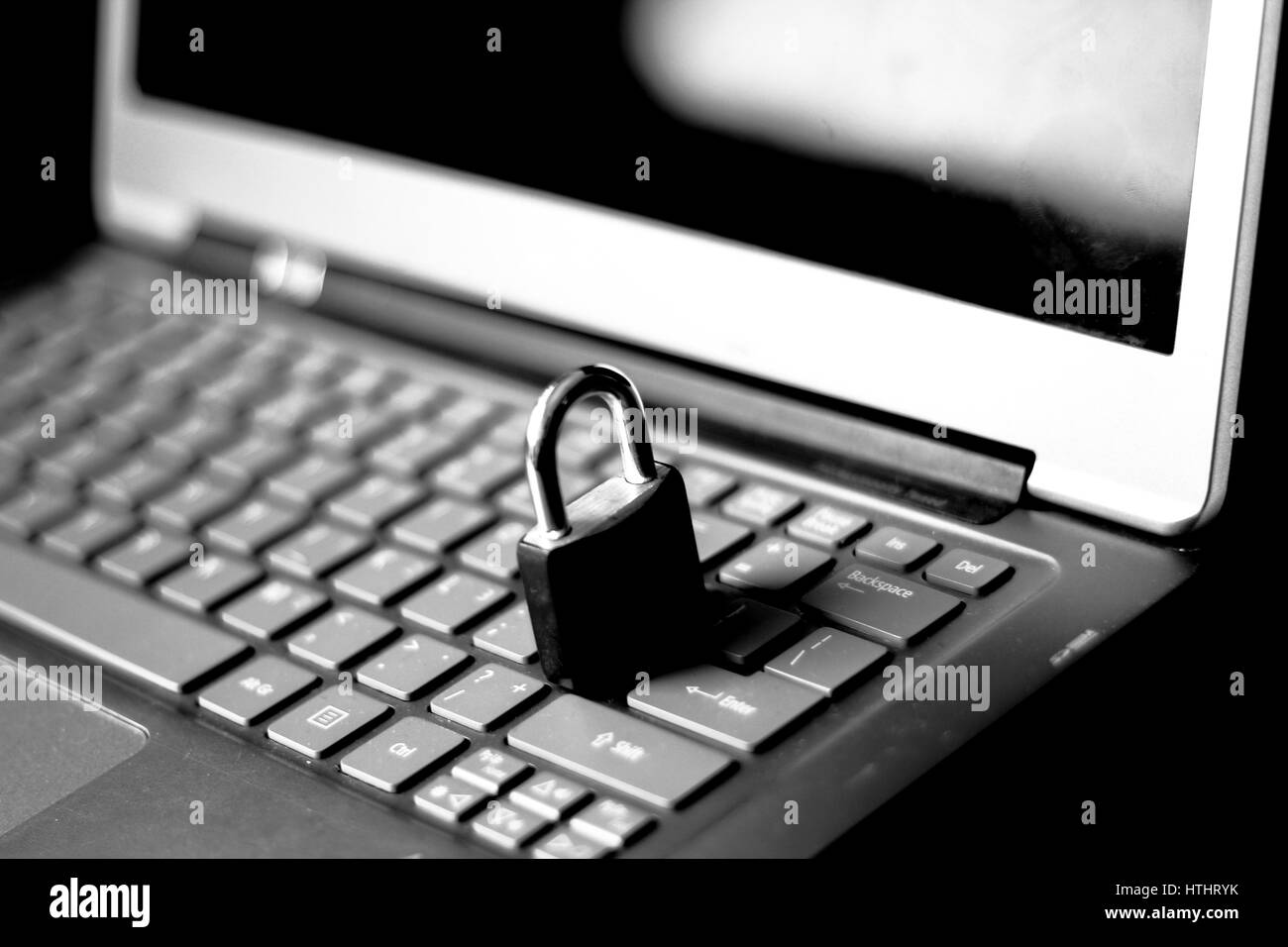 Padlock on a keyboard, internet and data security - Stock Image