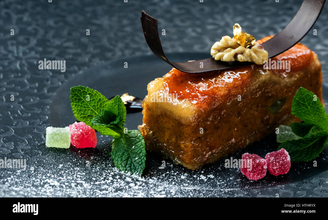 Marzipan dessert. Marzipan is a confection consisting primarily of sugar or honey and almond meal (ground almonds), Stock Photo