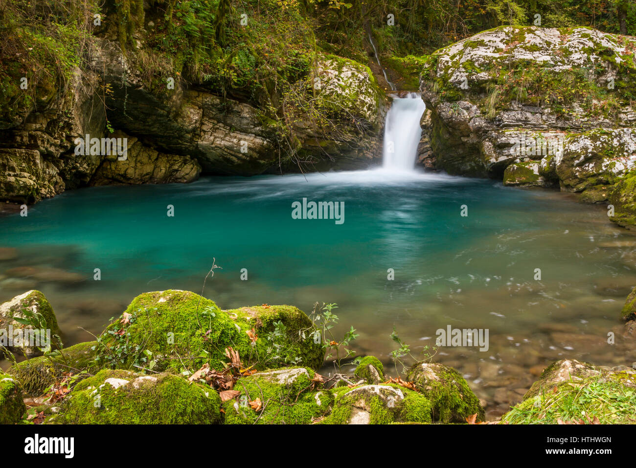 A small pond and a waterfall in the gorge Stavraetos, in Tzoumerka region, Epirus, Greece. - Stock Image
