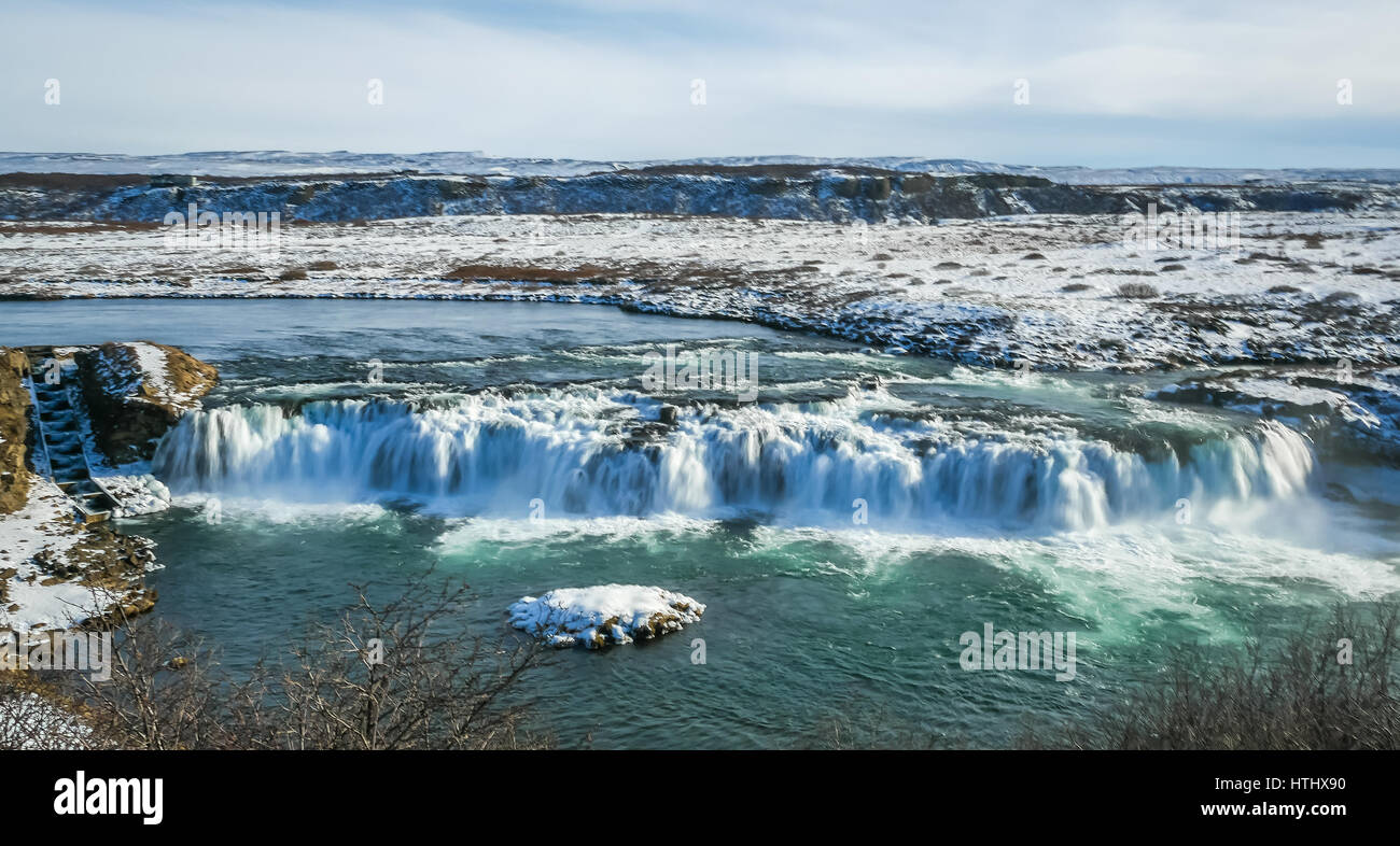 A broad frozen waterfall in Iceland in Winter - Stock Image