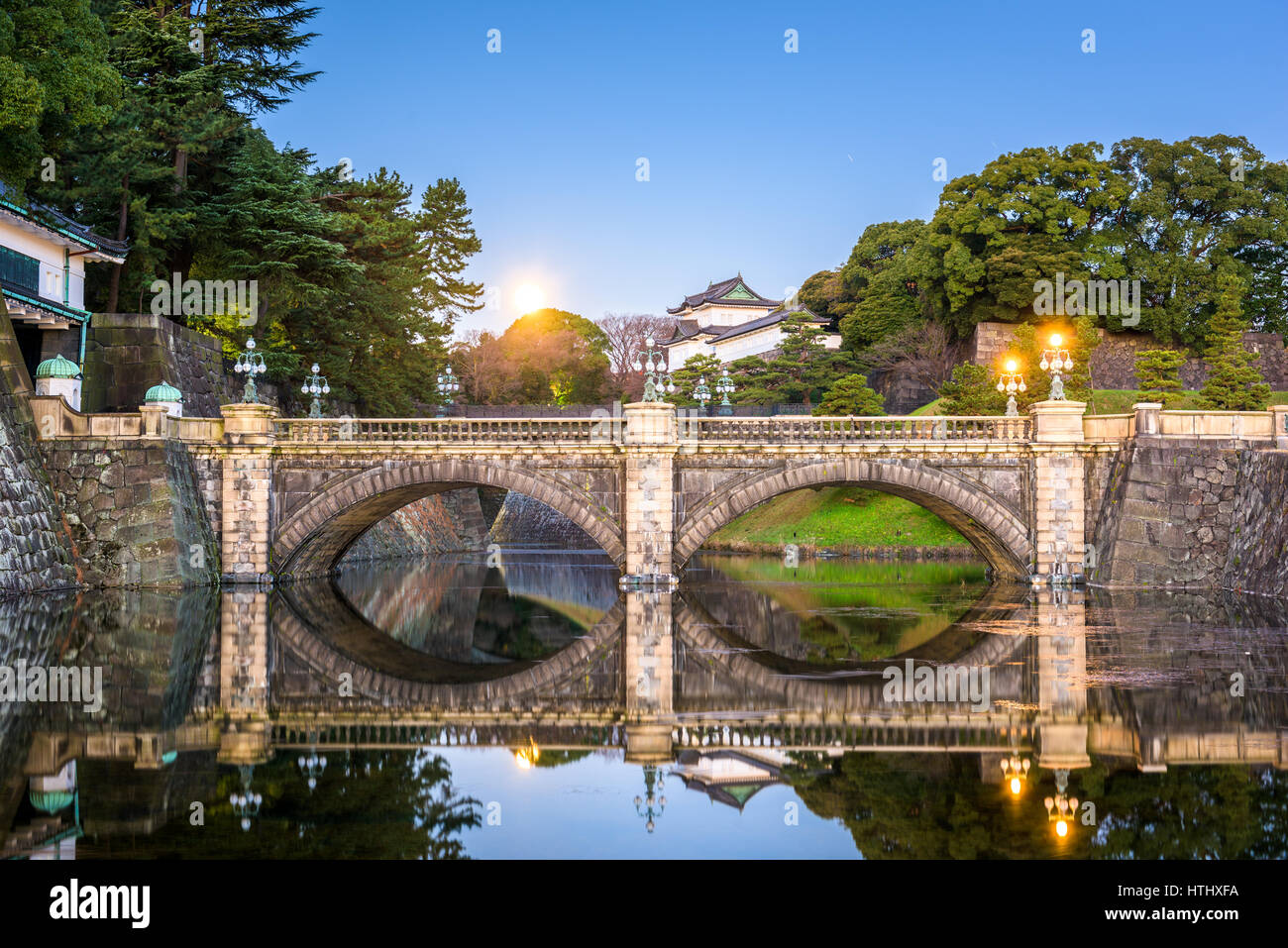 Tokyo, Japan at the Imperial Palace moat and bridge at night. - Stock Image