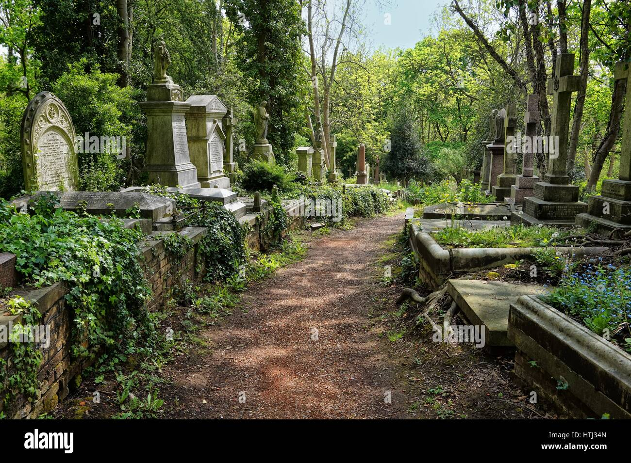 HIGHGATE, LONDON, UK - March 12, 2016: Graves in the East cemetery of Highgate Cemetery Stock Photo