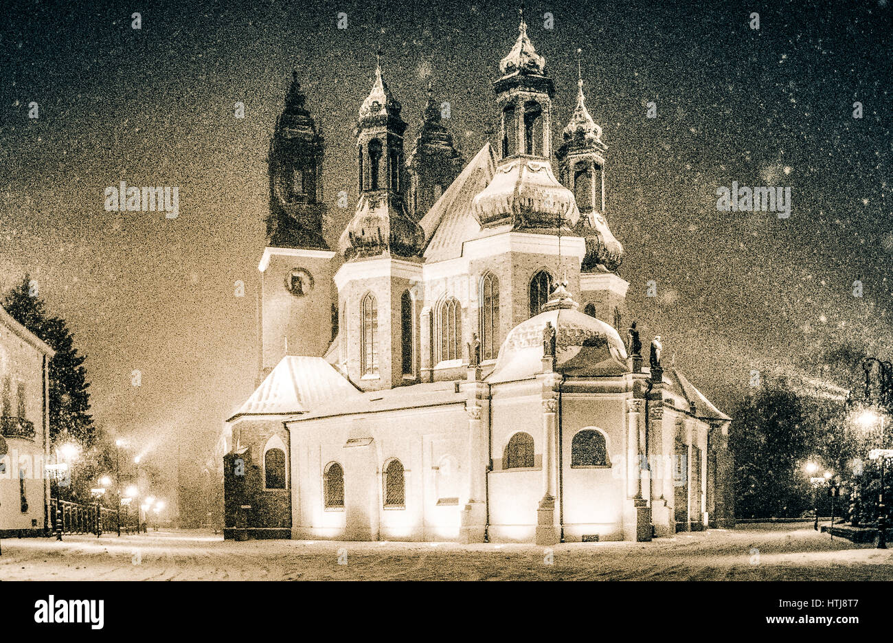 Cathedral in Poznan by night, winter and snow, historical church on the island Ostrow Tumski, Greater Poland. - Stock Image