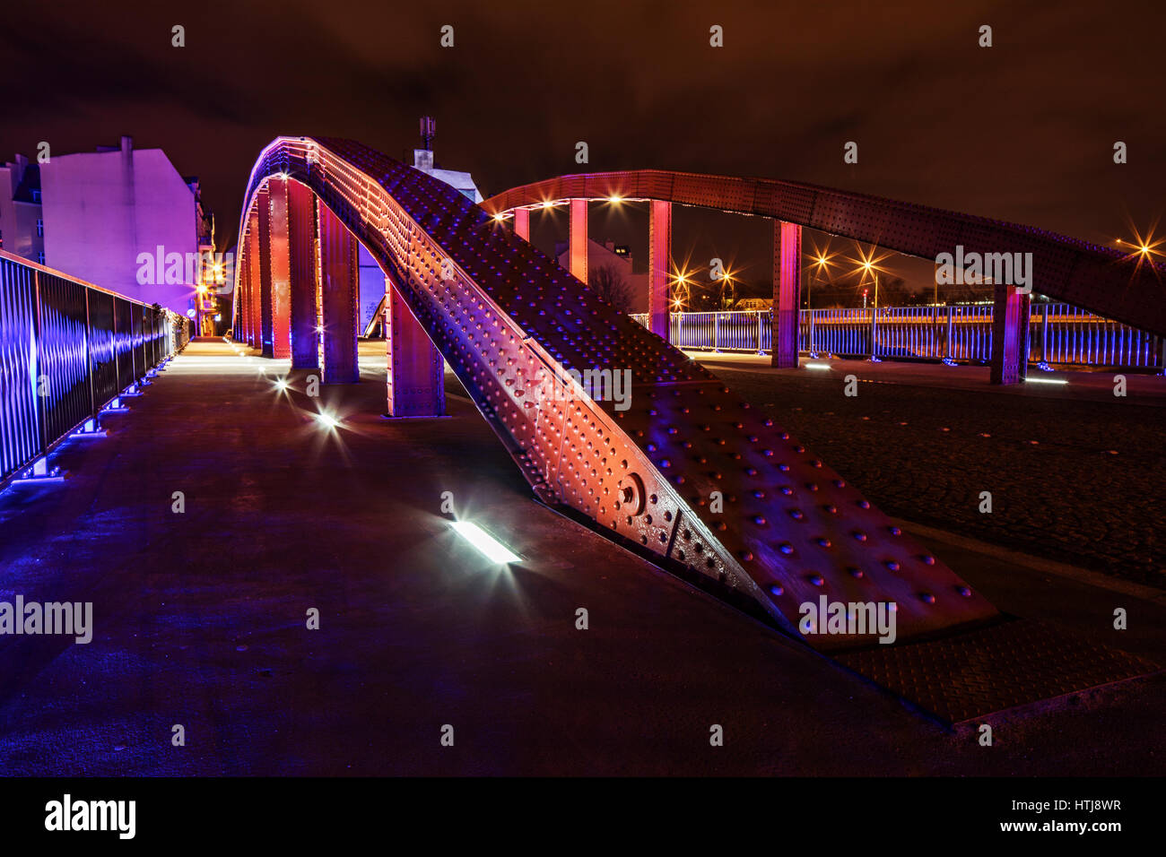 Poznan by night, the bridge over Cybina river between the cathedral island and the Srodka city disttrict. Stock Photo