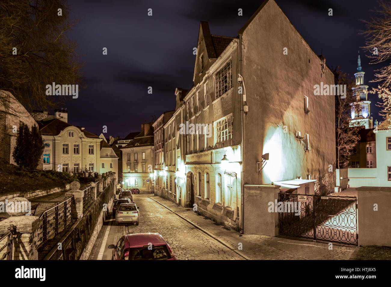 Night in the old center of Poznan - a street in the old town and the rebuildded colorful buildings, Polish cities. Stock Photo
