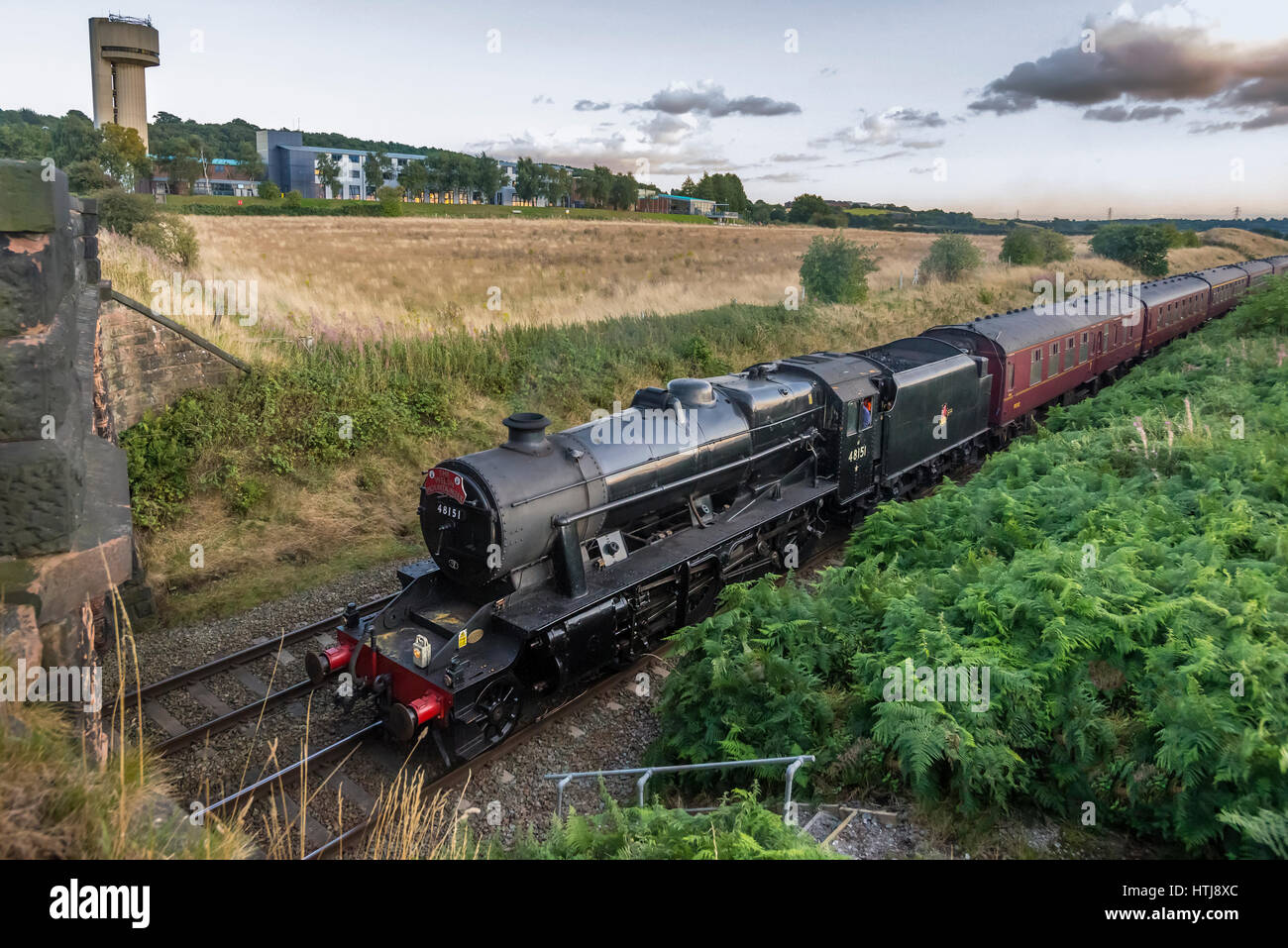 48151 Guage O Guild steam locomotive passing the Rutherford Daresbury nuclear physics laboratory at Daresbury near Stock Photo