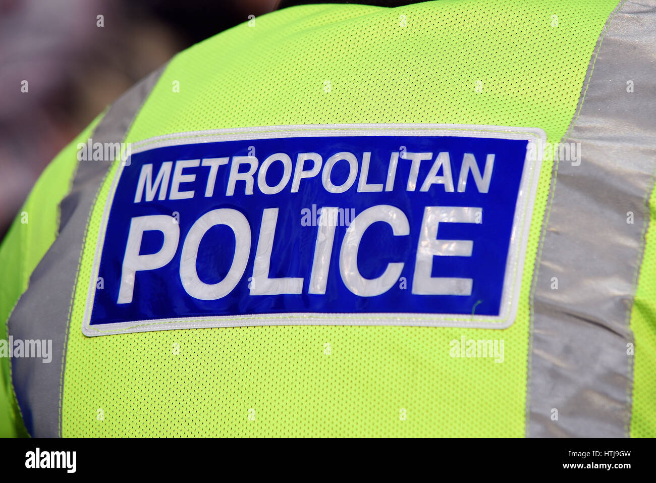 Metropolitan Police hi-viz jacket and reflective lettering Stock Photo