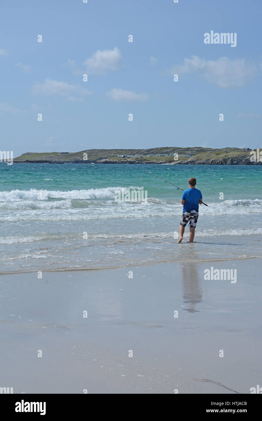Boy fishing in Atlantic Ocean, Connemara Western Ireland - Stock Image