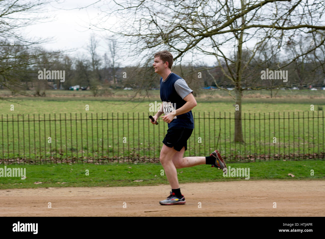 A male runner in the Teddy Hall Relays, Oxford, UK - Stock Image