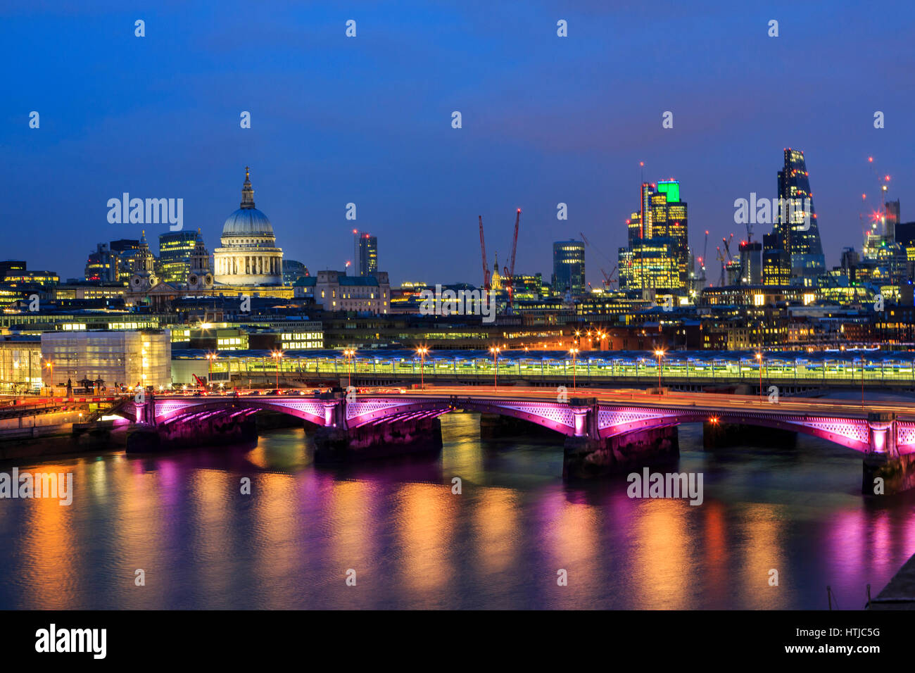 London skyline with St Paul's Cathedra, River Thames reflections and City of London twilight night panorama, London, Stock Photo