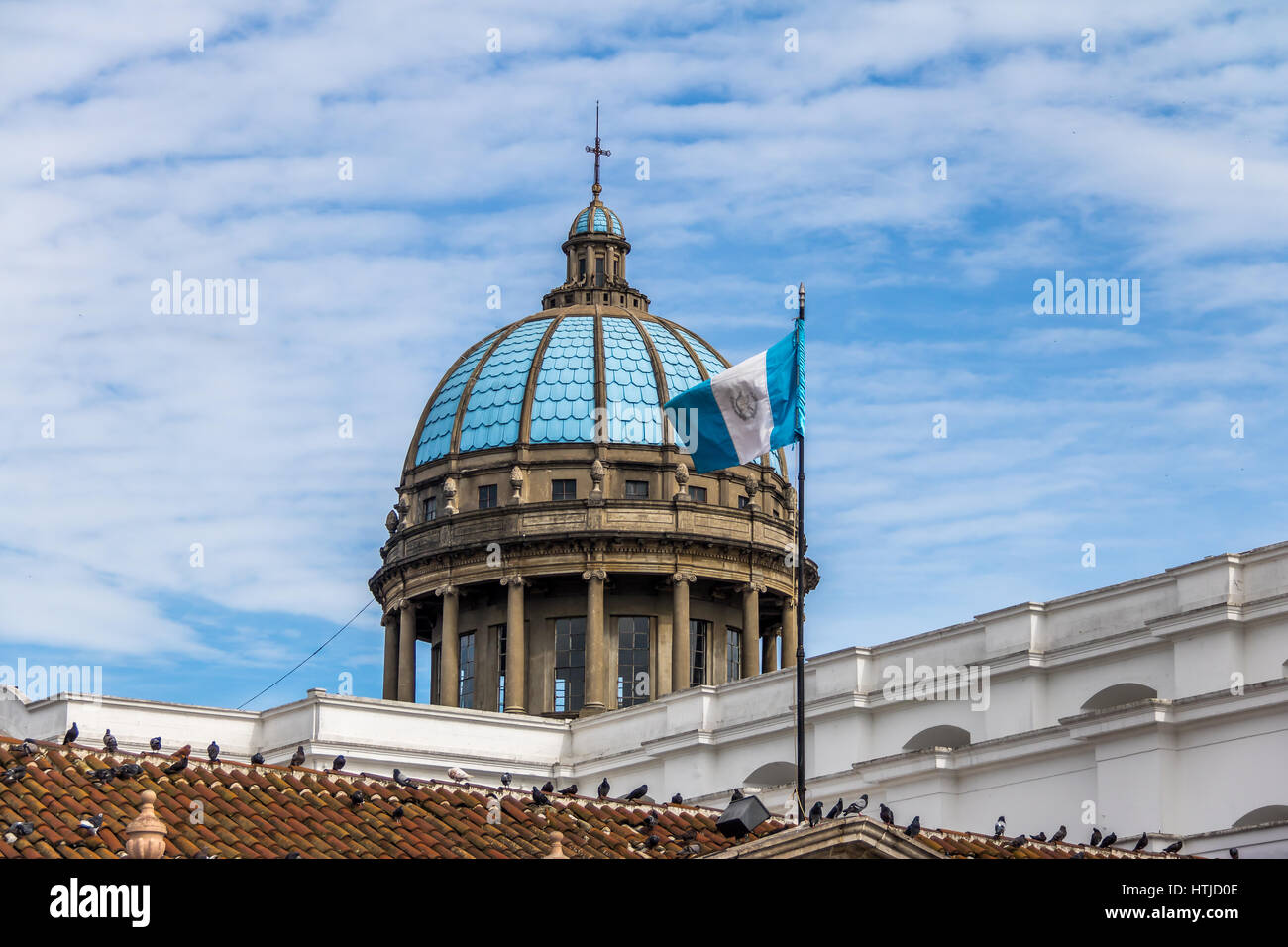 Dome of Guatemala City Cathedral and Guatemalan Flag - Stock Image