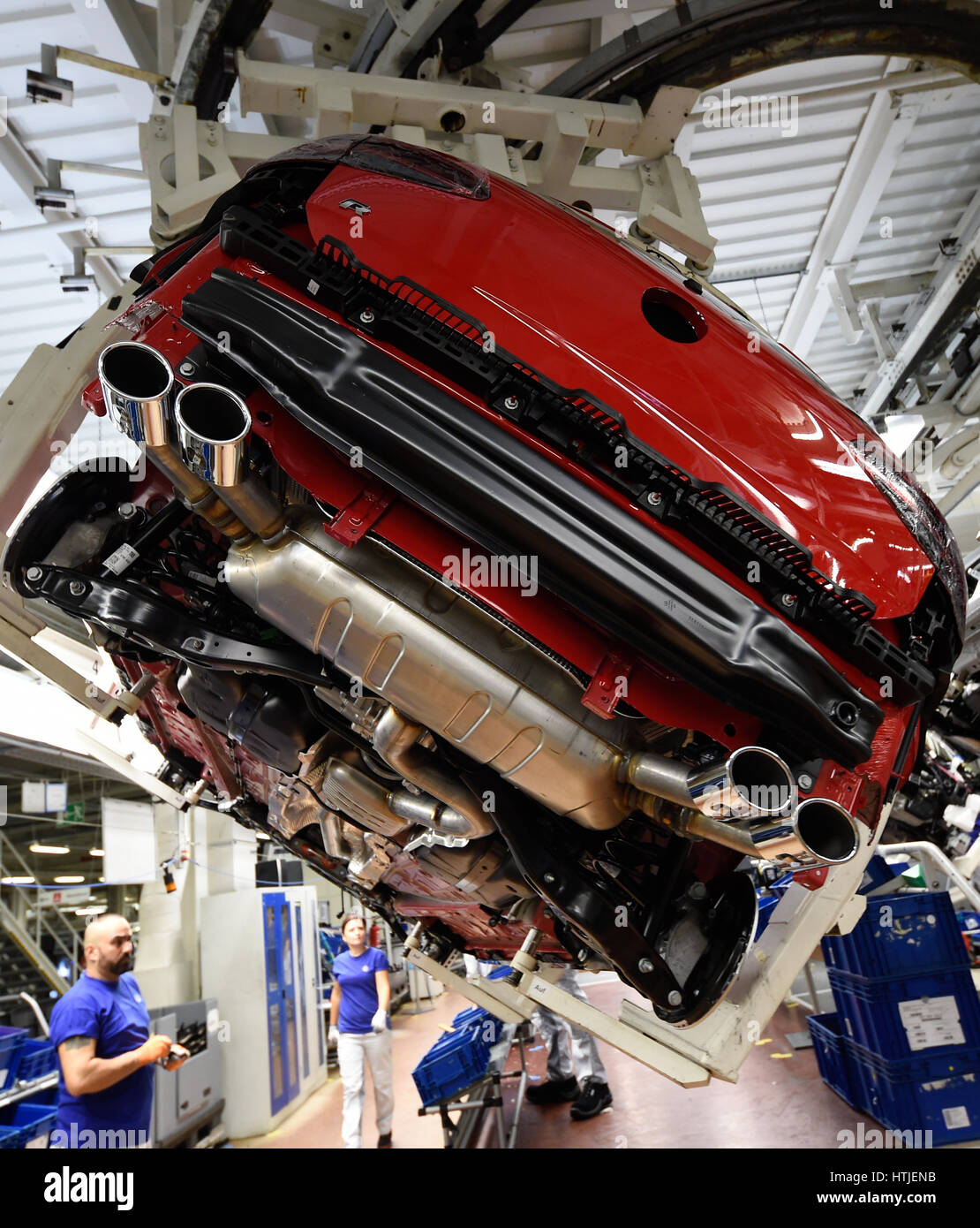 Exhaust systems of Volkswagen Golf cars are seen in a production line at the companies headquarter in Wolfsburg, - Stock Image