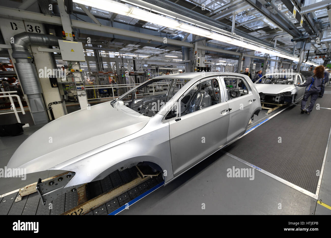 Volkswagen Golf cars are seen in a production line at the companies headquarter in Wolfsburg, March 9, 2017. VW - Stock Image