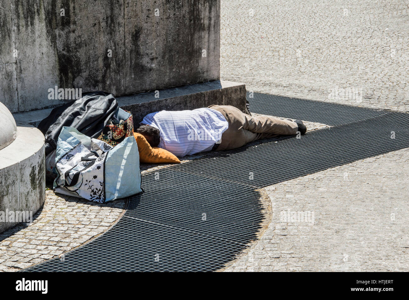 Fired businessman, unemployment sleeping on the street in waiting for a job - Stock Image