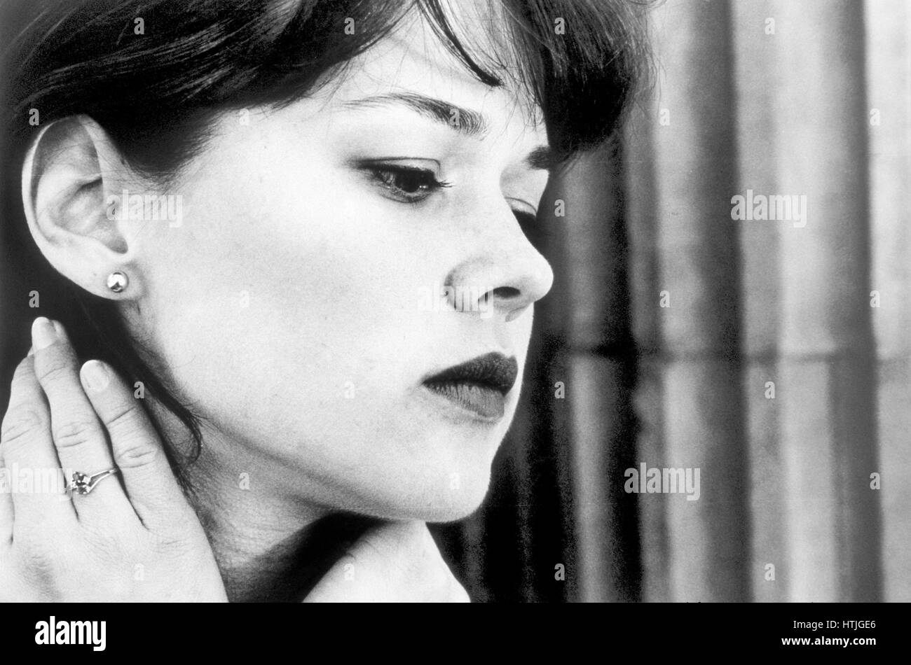 Woman with pensive expression - Stock Image