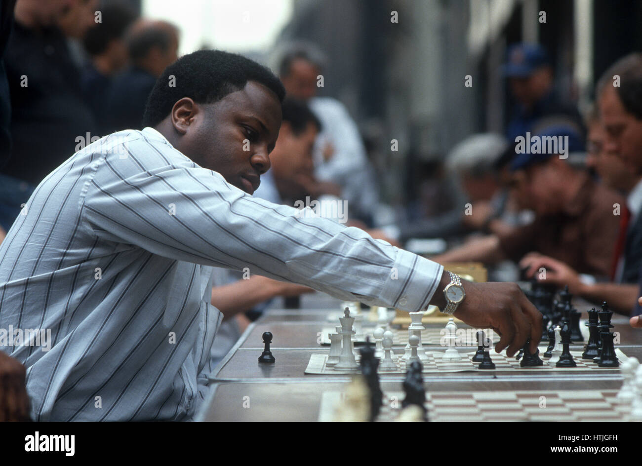 Chess Player at Sidewalk Concession - Stock Image