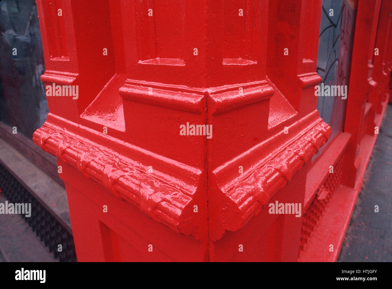 Very Colorful Red Corner of Storefront - Stock Image