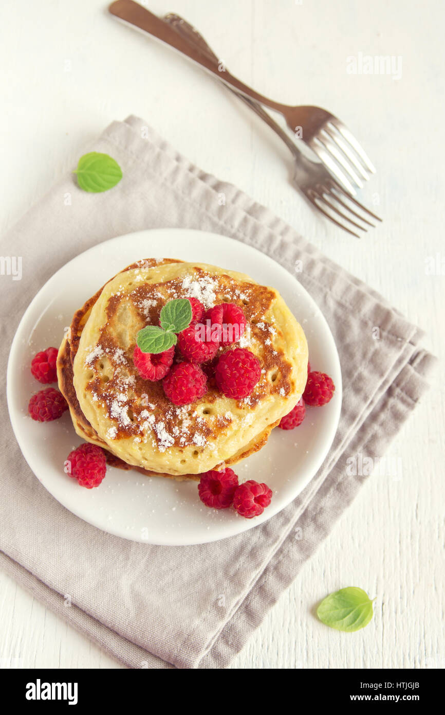 Stack of fresh pancakes with berries (raspberries) on white plate, copy space - healthy homemade vegan vegetarian Stock Photo