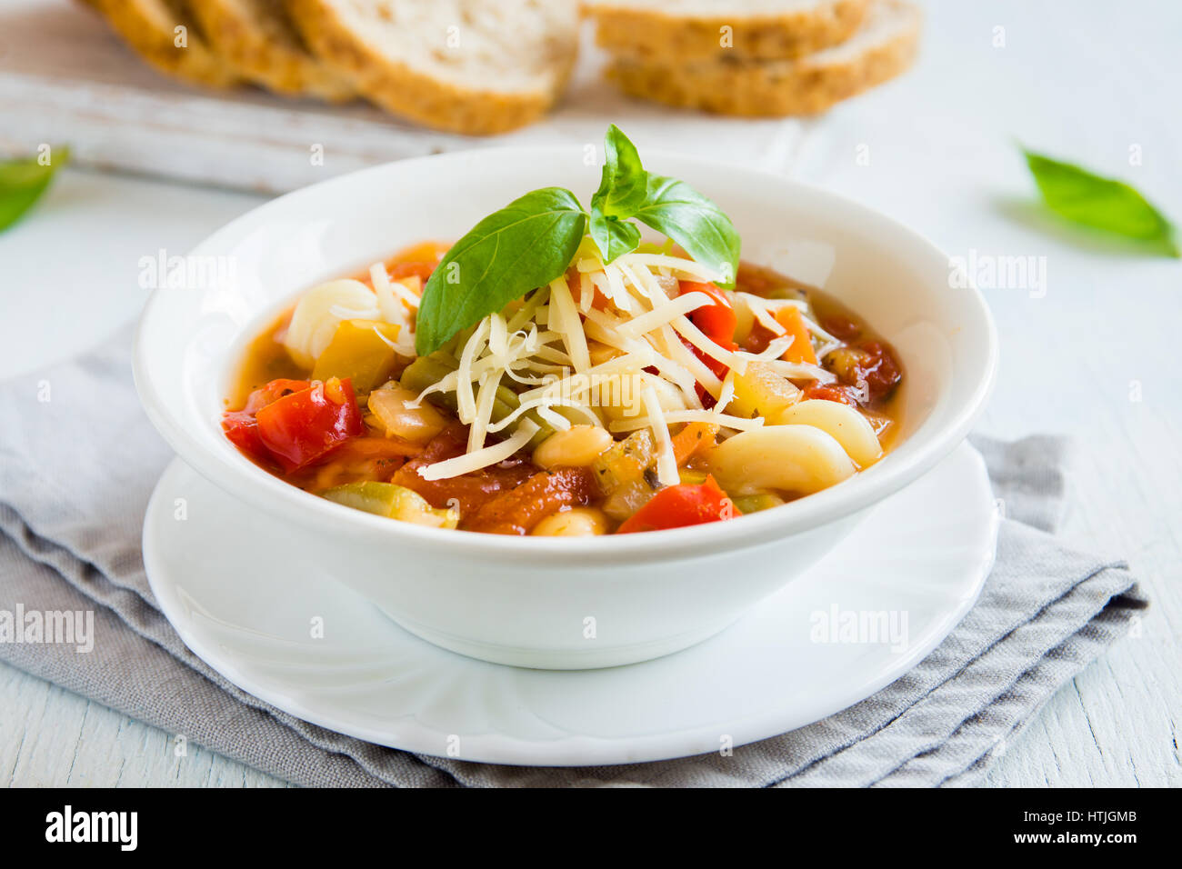 Homemade Italian Minestrone Soup with Cheese and Basil - healthy homemade hot vegetarian diet vegan meal food soup - Stock Image