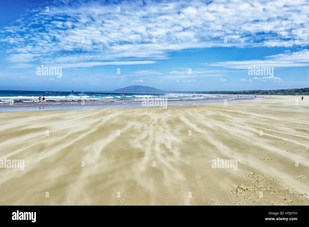 Sand being blown by the wind on Seven Mile Beach, Gerroa, Illawarra Coast, New South Wales, NSW, Australia - Stock Image