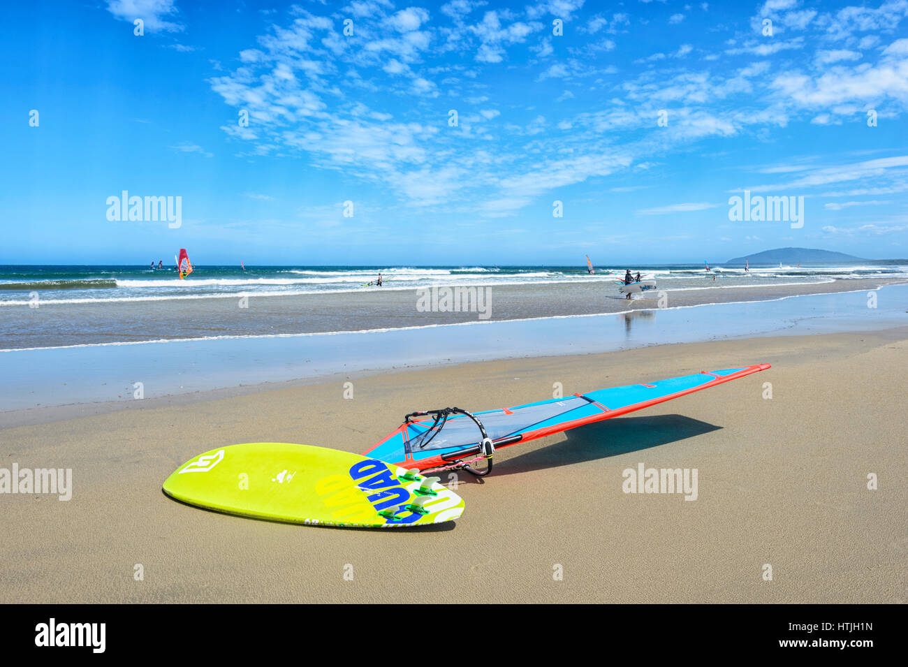 Yellow windsurfing board on Seven Mile Beach, Gerroa, Illawarra Coast, New South Wales, NSW, Australia - Stock Image