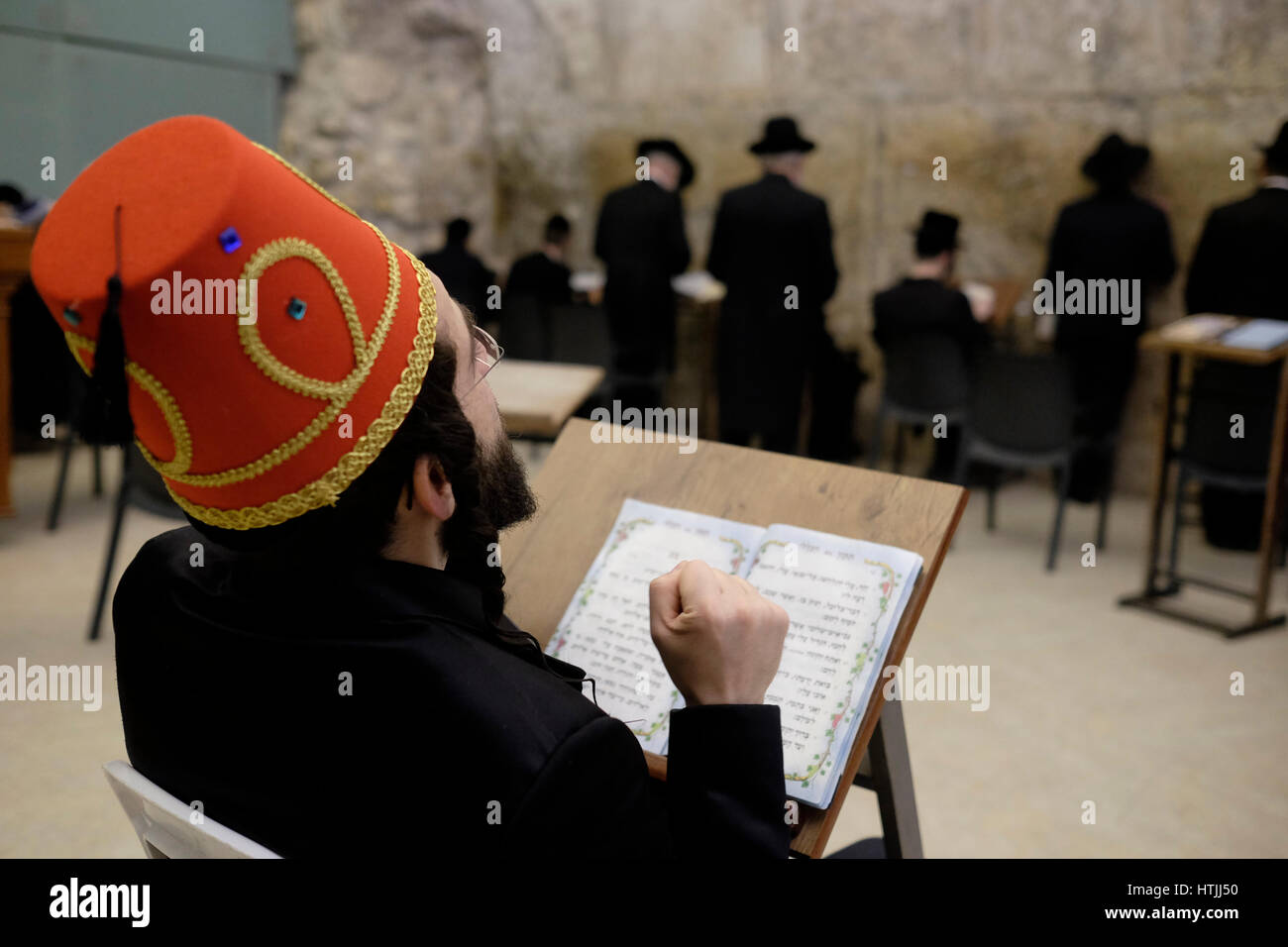 An Ultra Orthodox Jew wearing a traditional Muslim Tarboosh or Fez hat  costume during Purim festival 834222f54e46