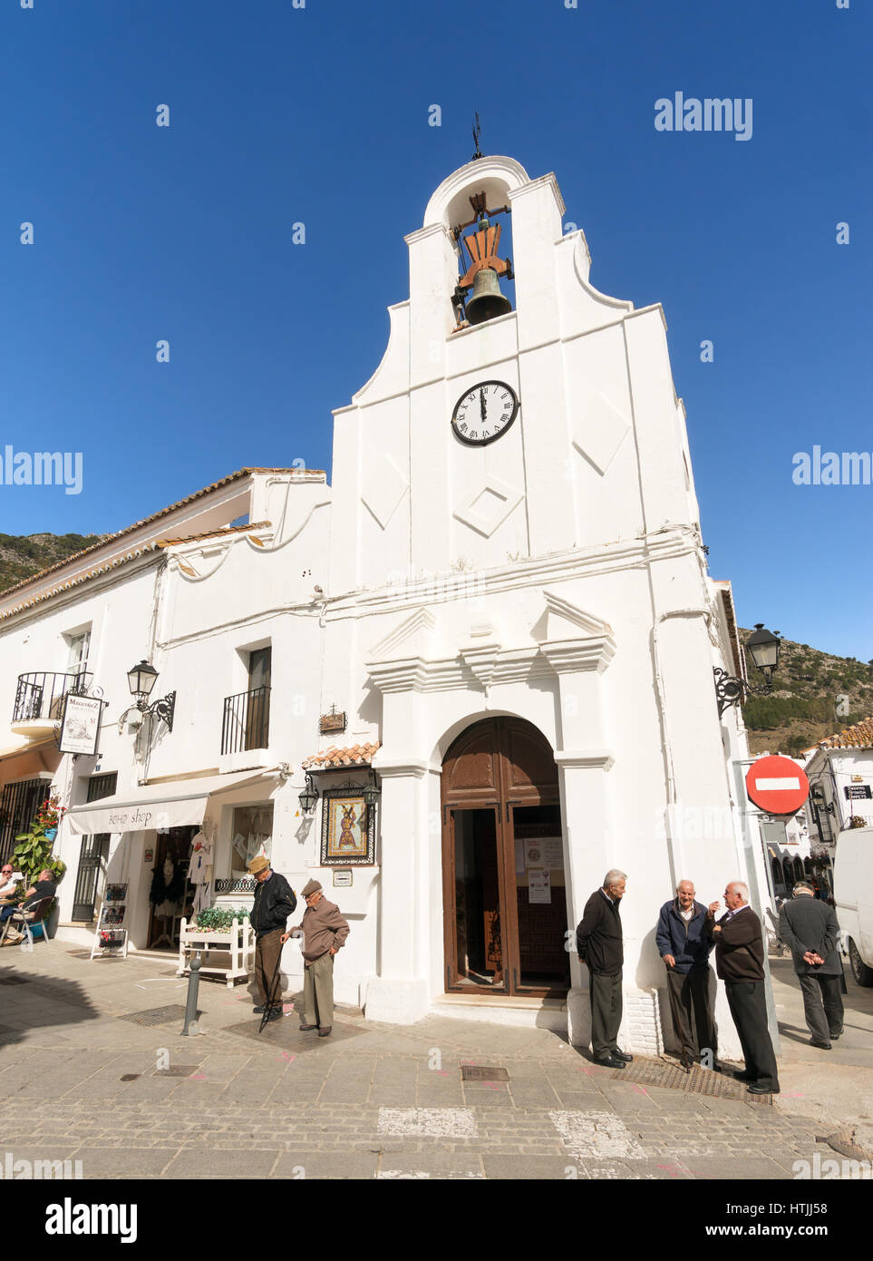 A group of older local men outside the church of San Sebastian, Mijas, Andalusia, Spain, Europe - Stock Image