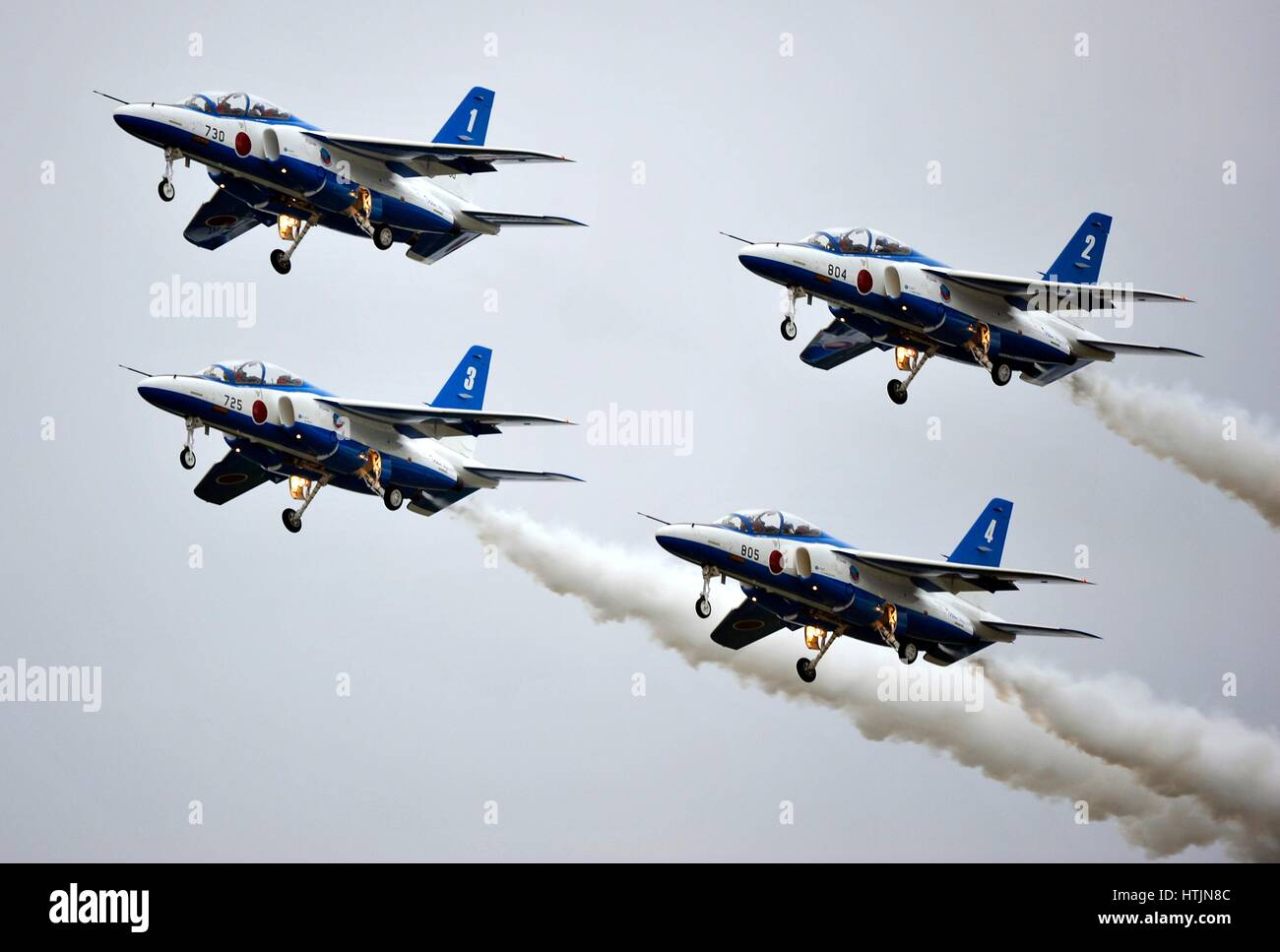 The Blue Impulse Japanese aerobatic demonstration team performs a four-ship formation flyby over the Misawa Air - Stock Image