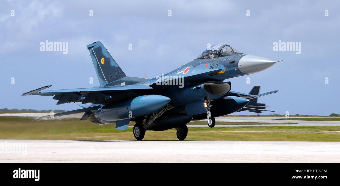 A Japanese Self-Defense Force Mitsubishi F-2 fighter jet aircraft lands at the Anderson Air Force Base to begin - Stock Image