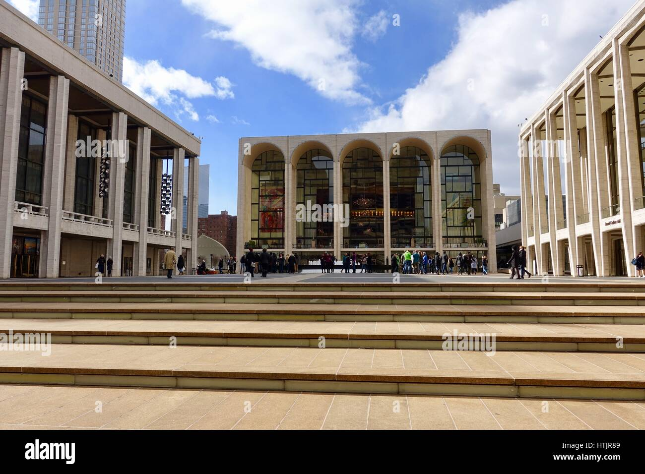 Daytime gathering of people in front of Lincoln Center, New York, New York, USA - Stock Image