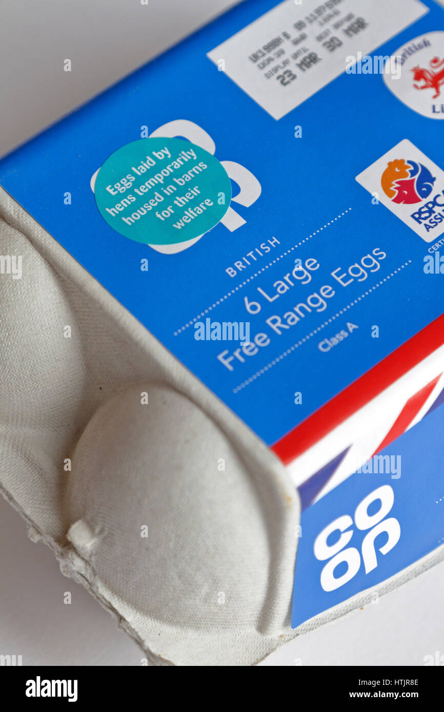 Sticker on an egg box stating 'Eggs laid by hens temporarily housed in barns for their welfare' as a measure - Stock Image