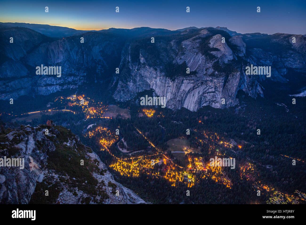 Panoramic aerial bird's eye view of famous Yosemite Valley illuminated in beautiful post sunset twilight during - Stock Image