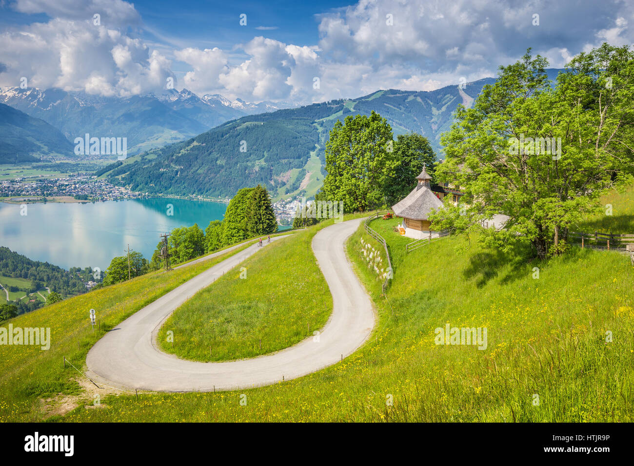 Winding mountain road in beautiful mountain scenery in the Alps in summer, Zell am See, Salzburg Land, Austria Stock Photo
