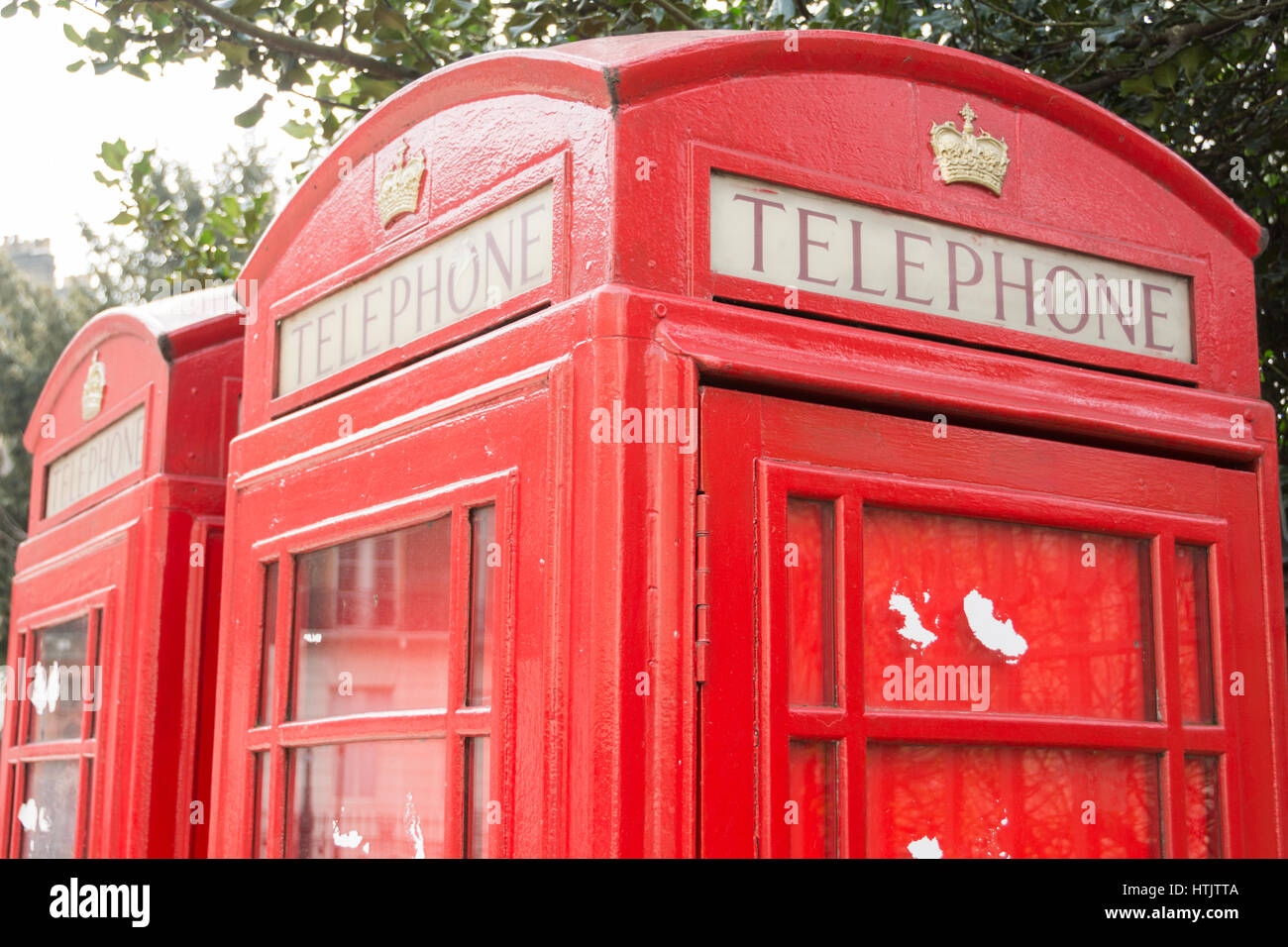 A red telephone kiosk in Russell Square, London, England, UK - Stock Image