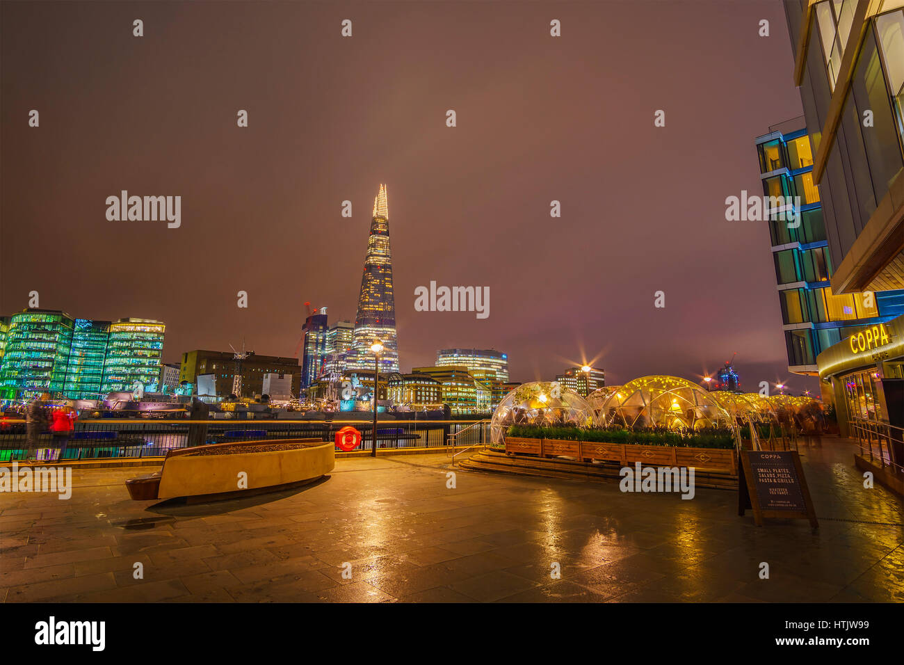Streets of London and night life in winter next to Thames river. London, United Kingdom. - Stock Image
