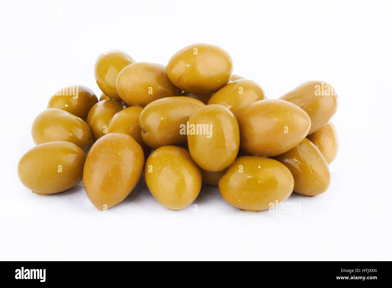 Green olives on a white background - Stock Image