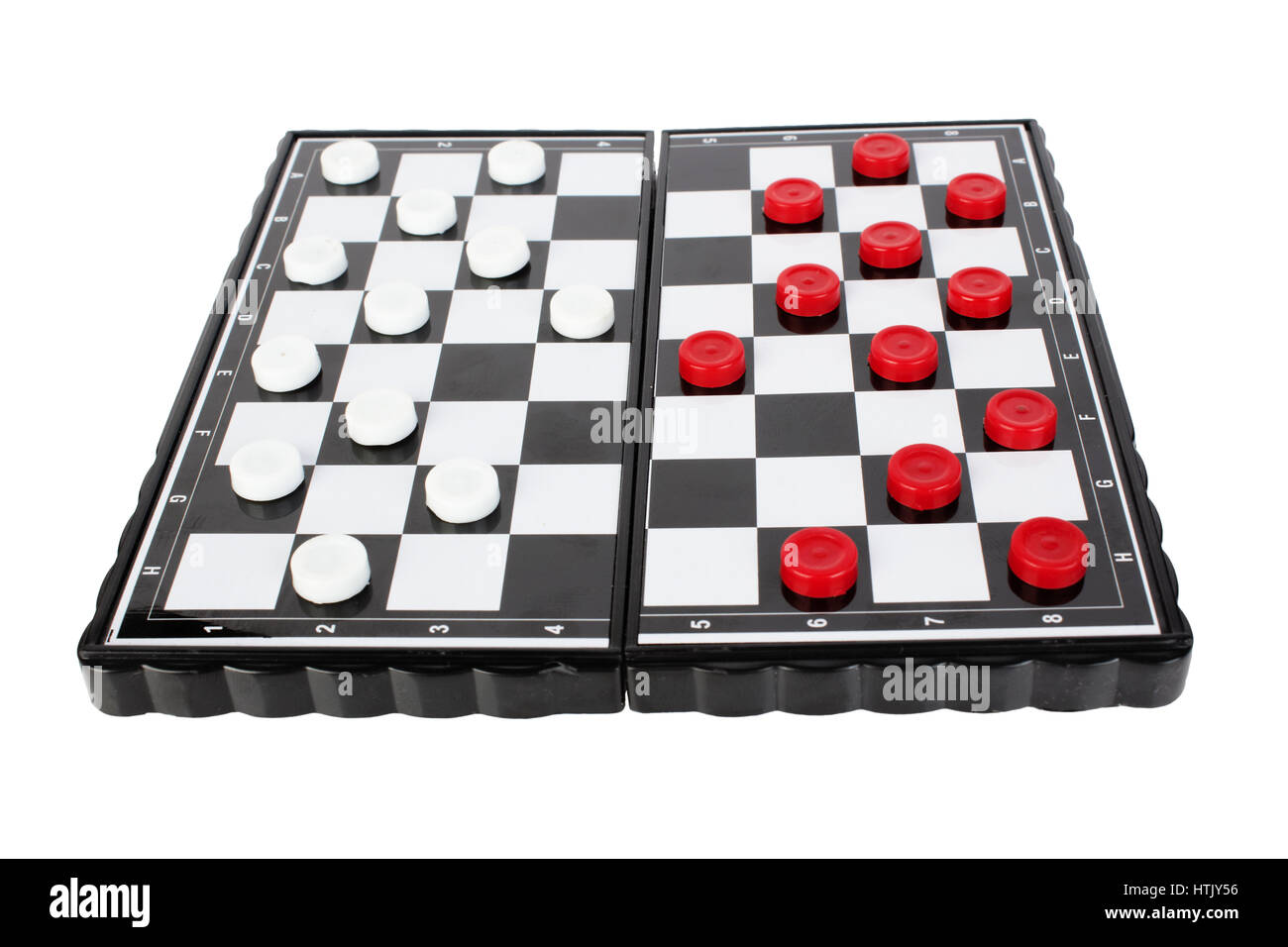 white and black checkers on a checker-board, isolated on white Stock Photo