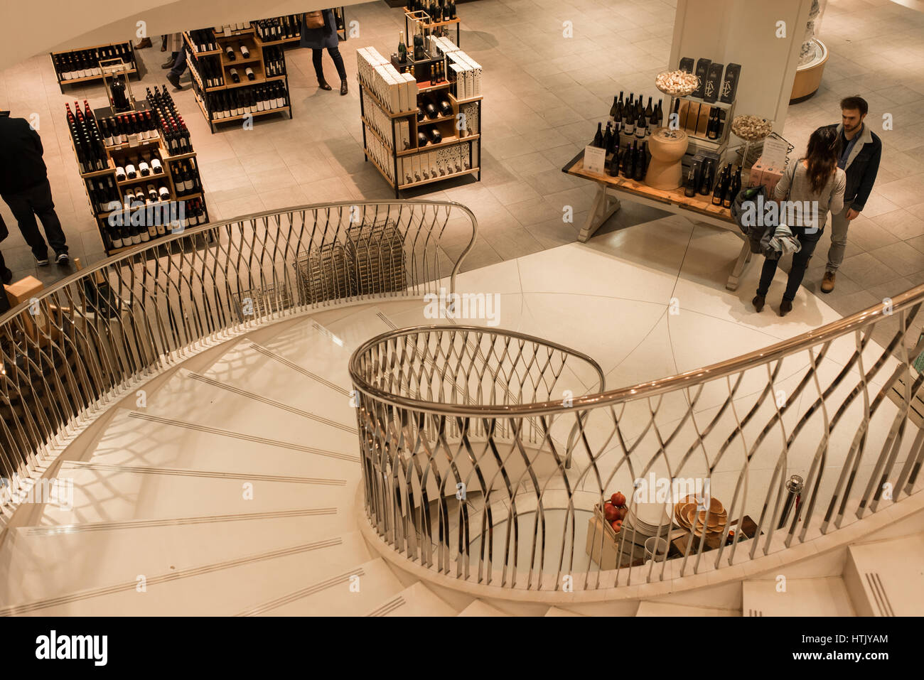 Interiors of Fortnum & Mason with customers browising the wine collection. Fortnum & Mason is an upmarket - Stock Image