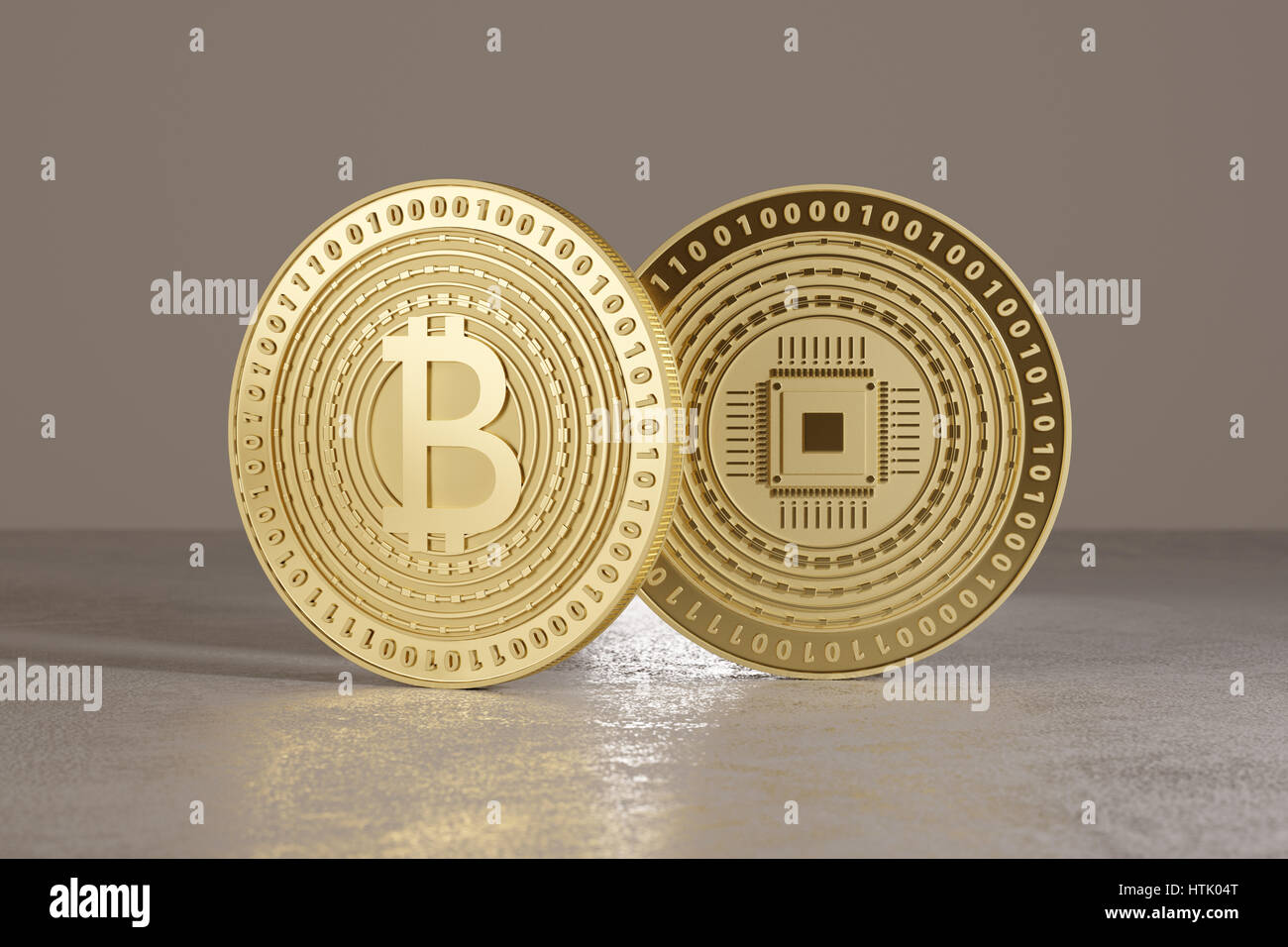 Two shiny golden bitcoins standing on metal floor as concept for financial technology and crypto-currency - Stock Image
