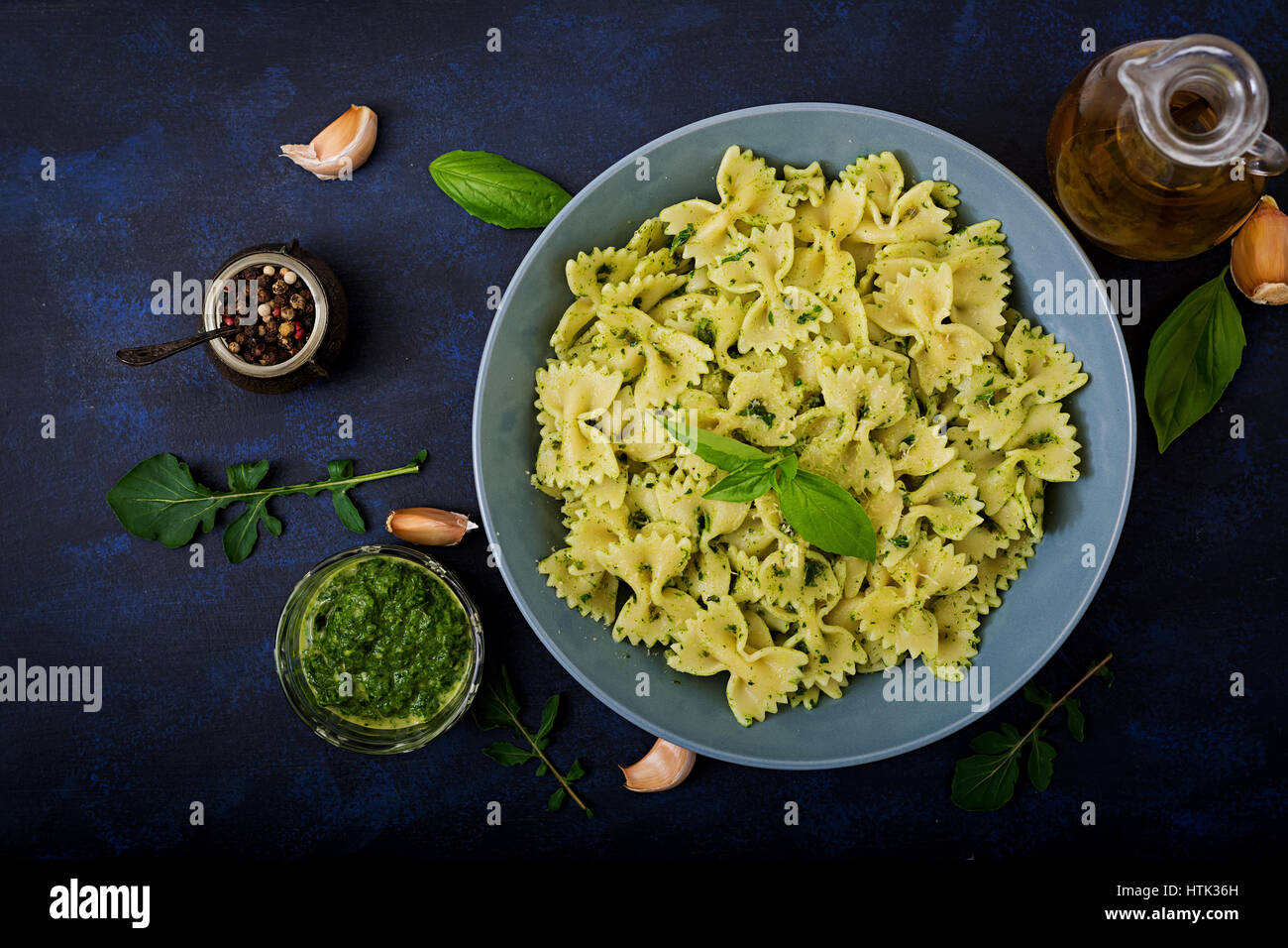 Vegan  Farfalle pasta in a basil-spinach sauce with garlic. Flat lay. Top view - Stock Image